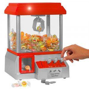 Maquina de caramelos con grua